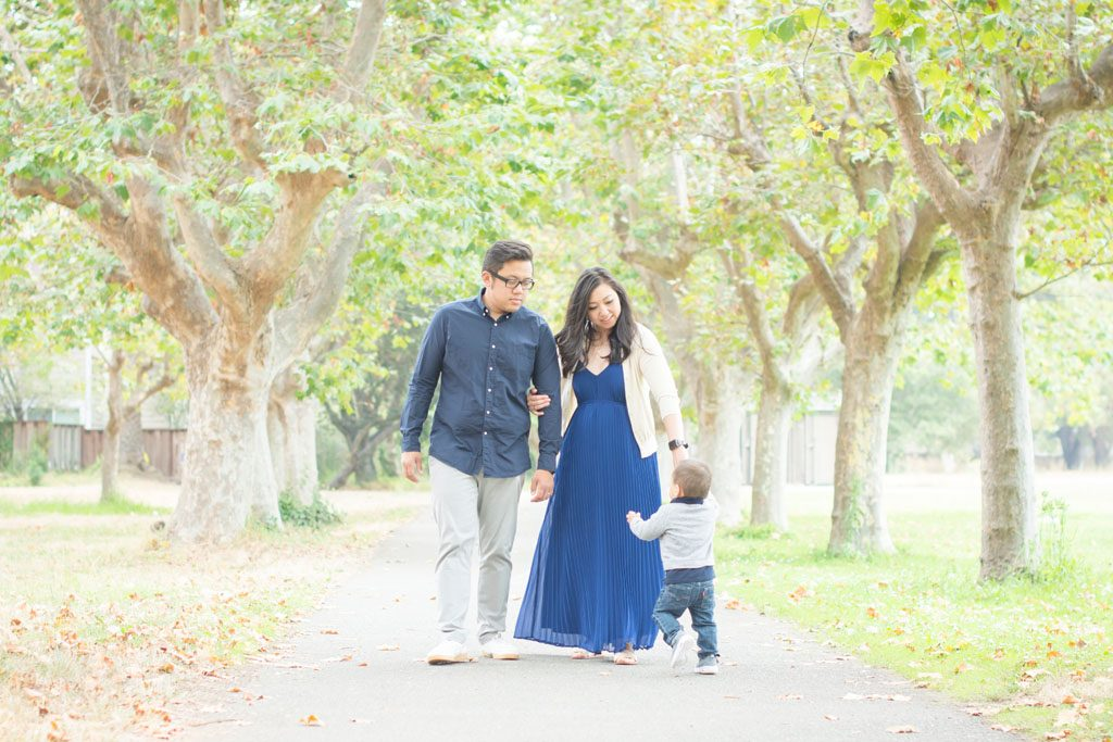 Family photos down the tree-lined path at Crab Cove in Alameda by Oakland photographer Jackie Rutan.
